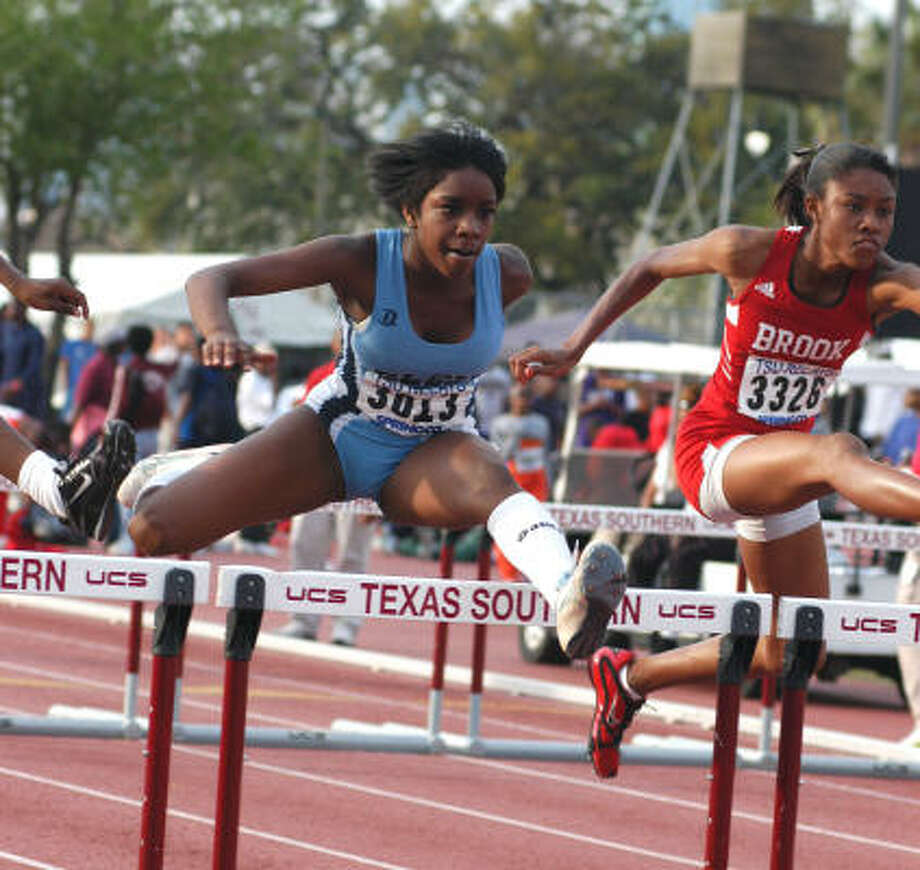 Girls hurdles: Alicia Perkins, ElsikPerkins, left, finished third in the 100-meter hurdles with a time of 13.95 seconds. Photo: L. Scott Hainline, For The Chronicle