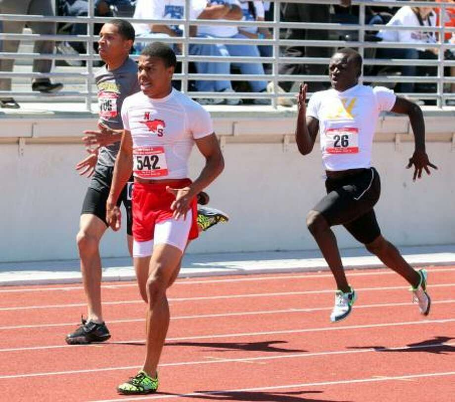Boys sprinters: Jermaine Authorlee, North Shore Authorlee, front, captured the gold medal in the 200-meter dash and was part of two relay victories. Photo: Gerald James, For The Chronicle