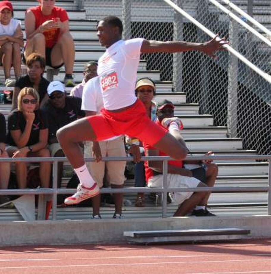 Boys jumps: Devonte Davis, North Shore Davis won gold in the triple jump with a leap of 51 feet, 3.34 inches. Photo: Gerald James, For The Chronicle