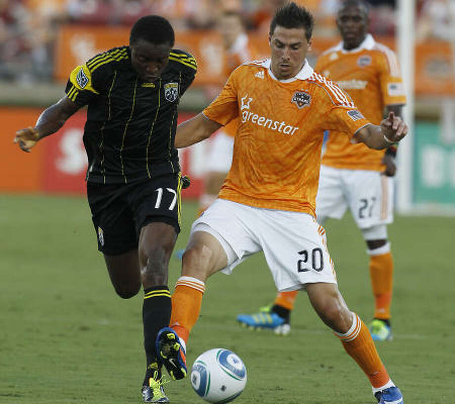 Columbus Crew 2, Houston Dynamo 0  Columbus' Emmanuel Ekpo (17)  battles for the ball against the Dynamo's Geoff Cameron (20)  in the first half at Robertson Stadium. Photo: Karen Warren, Houston Chronicle