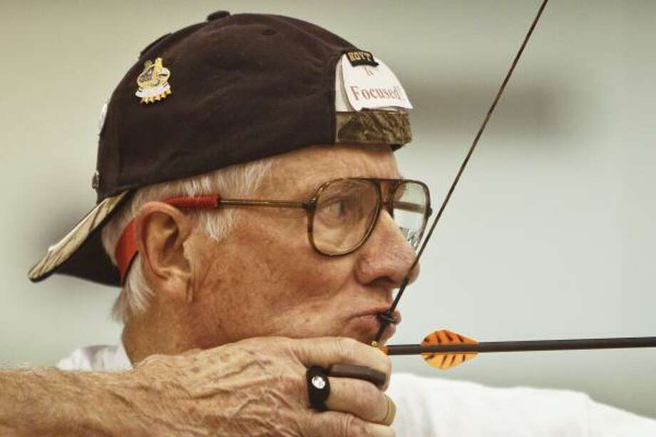 Ken Remley focuses as he draws back his bow while he and other archers take advantage of a day of practice at Reliant Center for the 2011 Summer National Senior Games in Houston.  Remley will compete in the 75-79 year-old age division in Archery. Photo: Michael Paulsen, Houston Chronicle