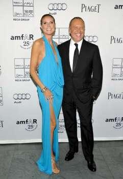Television personality and model Heidi Klum and amfAR Award of Courage recipient fashion designer Michael Kors Photo: Evan Agostini, Associated Press