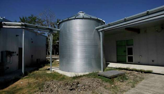 A water tank is installed behind Champion High School in Boerne. The school's water-collection system sustains 87 percent of the campus' irrigation needs. Photo: Omar Perez/operez@express-news.net / SAN ANTONIO EXPRESS-NEWS