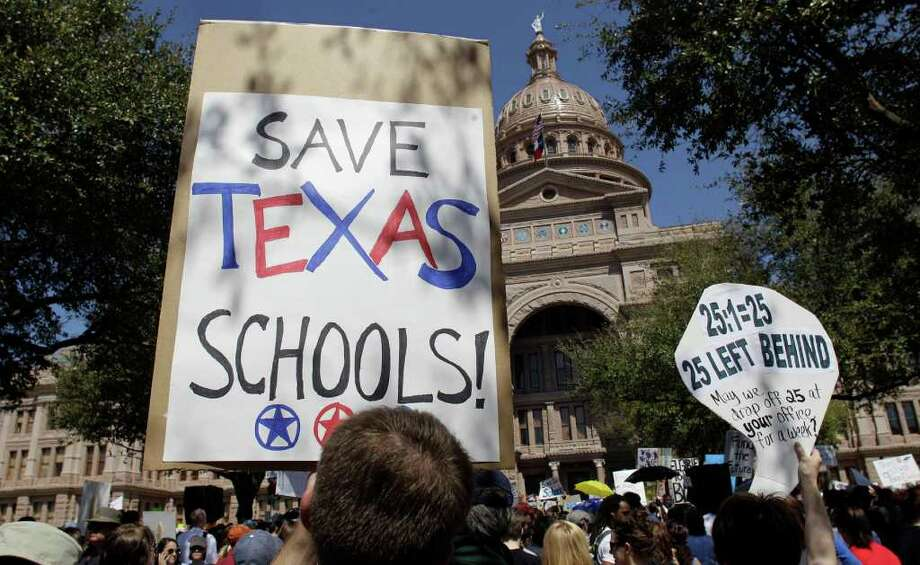 Thousands of teachers, students and parents rally at the Capitol in Austin on March 12 to protest cuts in education funding. Photo: Associated Press File Photo / AP