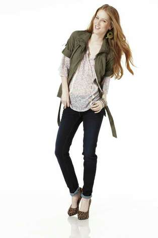 Lace top over skinny denim jeans from JCPenney. Photo: Courtesy Photo/JCPenney / JCPenney