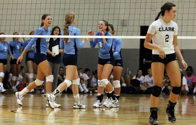 The Johnson volleyball team react after defeating Clark in girls volleyball at Clark on Wednesday, August 17, 2011. Johnson won over Clark in three straight games. Kin Man Hui/kmhui@express-news.net Photo: KIN MAN HUI, -- / San Antonio Express-News