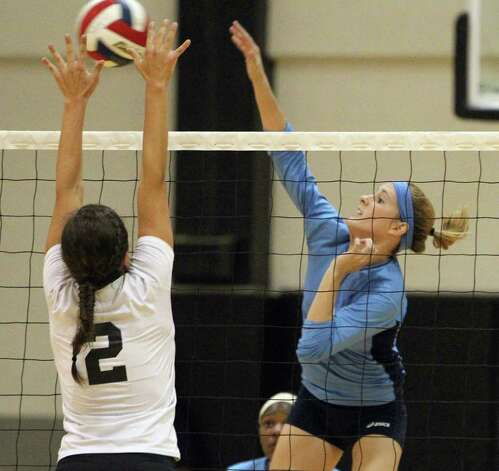 Johnson's Kassie Frietag (09) hits against Clark's Abby Glosup (02) in girls volleyball at Clark on Wednesday, August 17, 2011. Johnson defeated Clark in three straight games. Kin Man Hui/kmhui@express-news.net Photo: KIN MAN HUI, -- / San Antonio Express-News