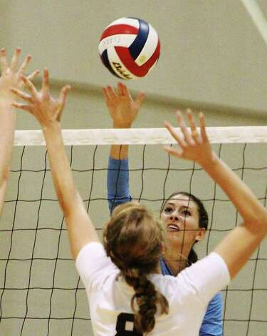 Johnson's Sarah Wilson hits over Clark's  Jenn Garrett (08) in girls volleyball at Clark on Wednesday, August 17, 2011. Johnson defeated Clark in three straight games. Kin Man Hui/kmhui@express-news.net Photo: KIN MAN HUI, -- / San Antonio Express-News