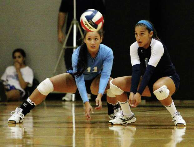Johnson's Lindsey Gawlik (left) and Ayssa Garcia eye a return of serve against Clark in girls volleyball at Clark on Wednesday, August 17, 2011. Johnson defeated Clark in three straight games. Kin Man Hui/kmhui@express-news.net Photo: KIN MAN HUI, -- / San Antonio Express-News