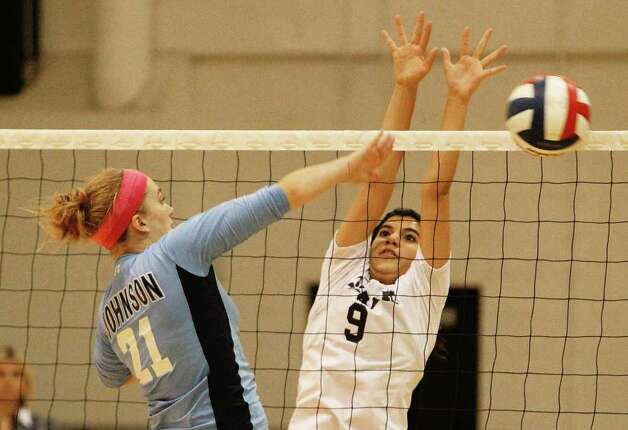 Johnson's Olivia Drummond (21) hits past Clark's Rosalyn Velasquez (09) in girls volleyball at Clark on Wednesday, August 17, 2011. Johnson defeated Clark in three straight games. Kin Man Hui/kmhui@express-news.net Photo: KIN MAN HUI, -- / San Antonio Express-News