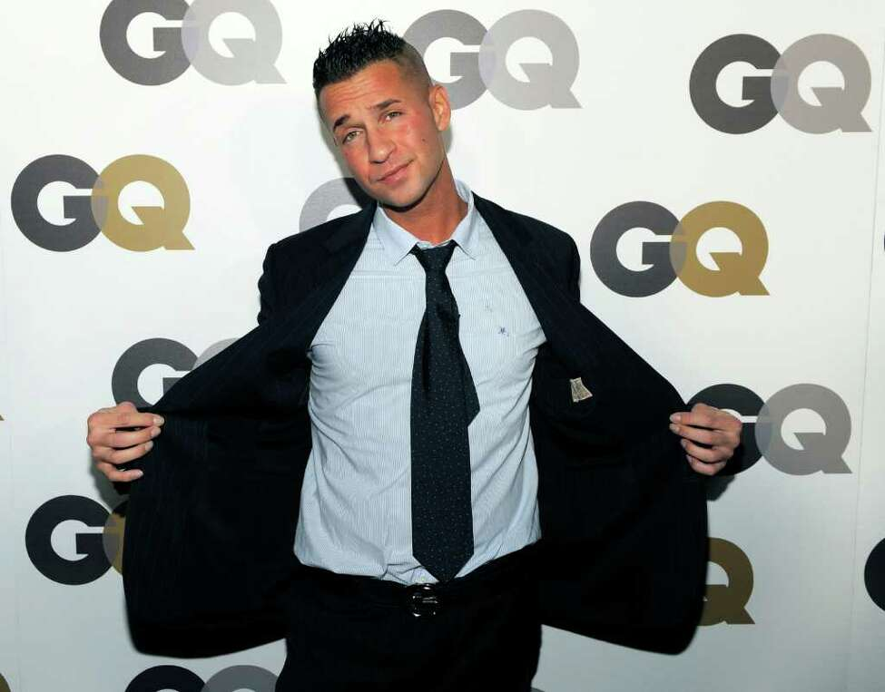 """FILE - In this Nov. 17, 2010 photo, Mike """"The Situation"""" Sorrentino poses at GQ magazine's 2010 """"Men of the Year"""" party in Los Angeles. Abercrombie & Fitch Co. is offering money to Mike """"The Situation"""" Sorrentino and his fellow """"Jersey Shore"""" cast members ?— so they'll stop wearing the brand on the show. The clothing company says in a news release posted Tuesday, Aug. 16, 2011, that it's concerned that having Sorrentino seen in its clothing could cause """"significant damage"""" to the company's image. The Ohio-based retailer says it has offered a """"substantial payment"""" to Sorrentino and producers of the MTV show so he'll wear something else. (AP Photo/Chris Pizzello)"""