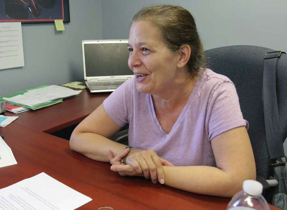Diana Babcock, a dual recovery peer specialist, sits in the offices at The Empowerment Exchange, Troy on Wednesday, Aug. 17, 2011. (Erin Colligan / Special To The Times Union)