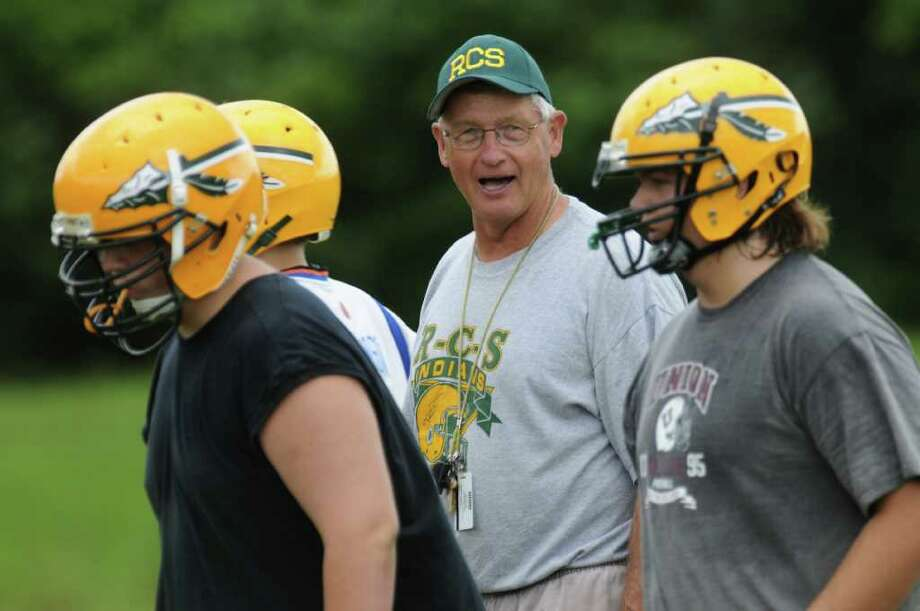 High school football -- Ravena football coach Gary VanDerzee encourages his players during practice on Tuesday Aug. 16, 2011 in Ravena, NY.   (Philip Kamrass / Times Union) Photo: Philip Kamrass / 00014288A