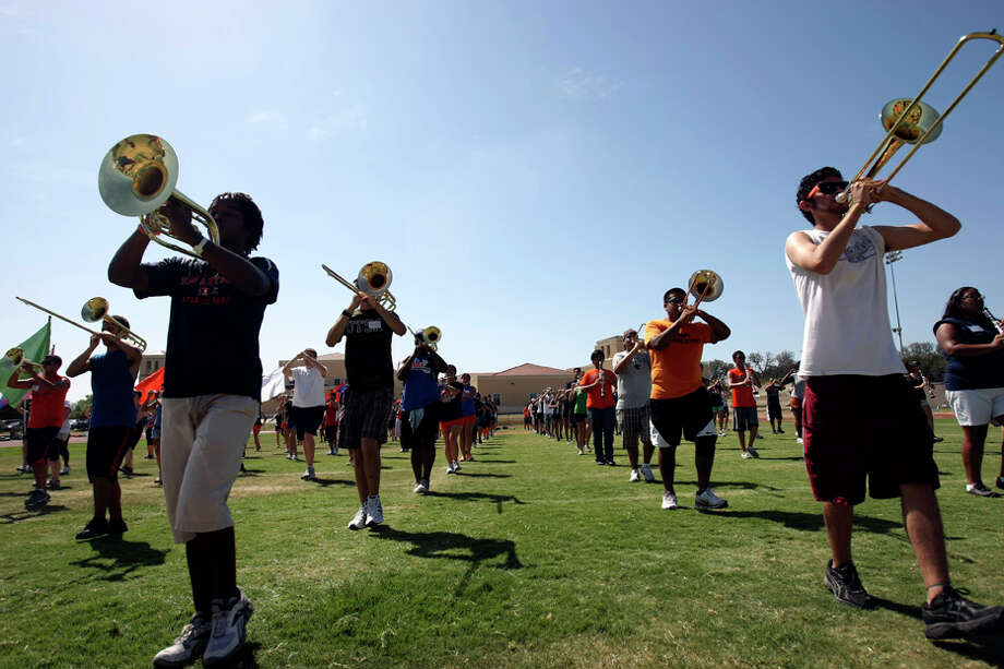 The UTSA Band didn't let Wednesday's heat halt practice for its first halftime show during the Roadrunners' Sept. 3 football game against Northeastern State. Photo: Helen L. Montoya/hmontoya@express-news.net / SAN ANTONIO EXPRESS-NEWS