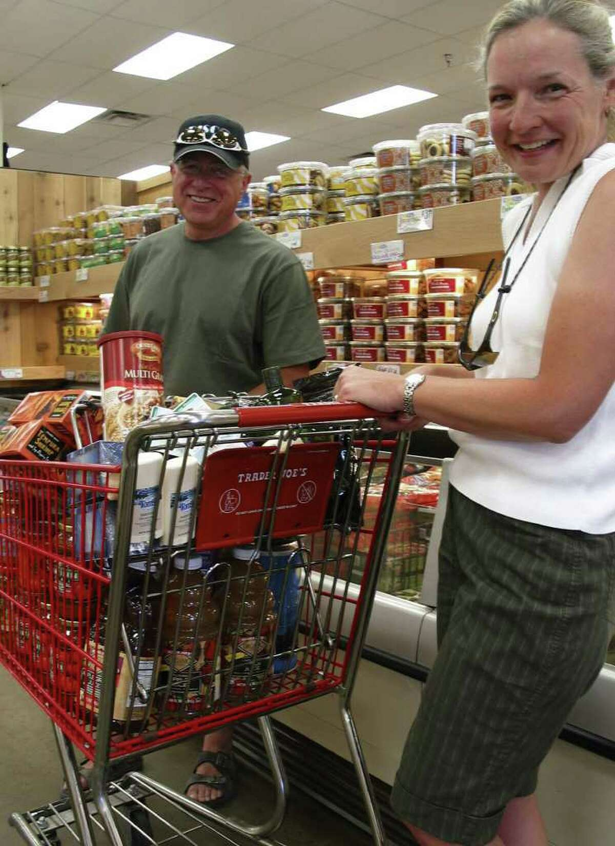 Lisa, right, and Steve Mackey, of Durango, Colorado, pictured at the Trader Joe's grocery store in Santa Fe, New Mexico, brought their RV to stock up on goods.