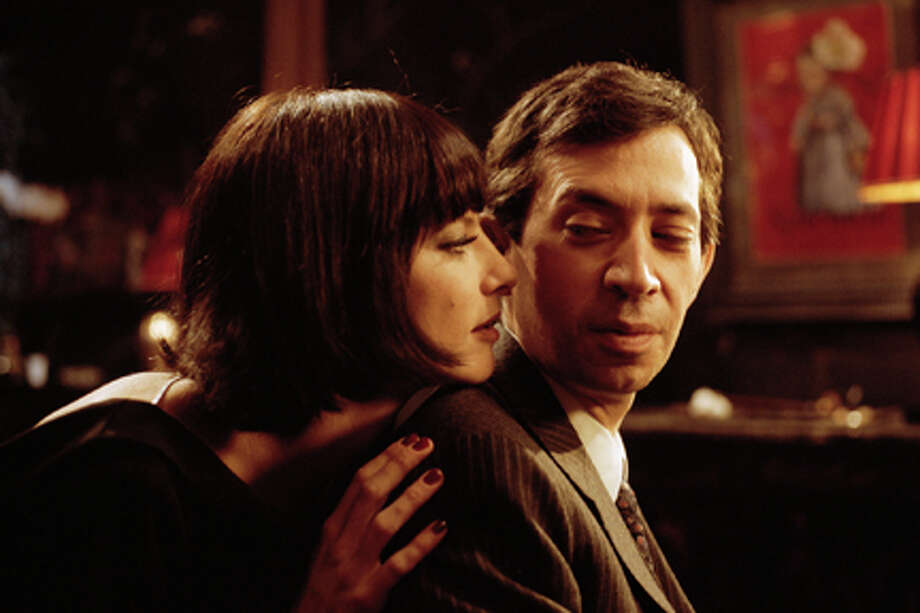 "Anna Mouglalis as Juliette Gréco and Eric Elmosnino as Serge Gainsbourg in ""Gainsbourg."""