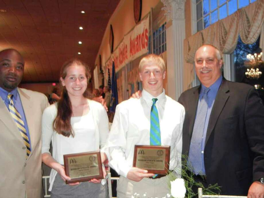 Ingrid Johnson, second from left, and Matt Yeager, second from right, display their plaques for being the Connecticut Scholastic                                High School Coaches Association's Scholar-Athletes for Staples. Flanking them are girls indoor and outdoor track coach Jesse McCray, left, and football coach Marce Petroccio. In addition to indoor and outdoor track, Johnson ran cross-country and Yeager played lacrosse as well as football. Photo: Contributed Photo