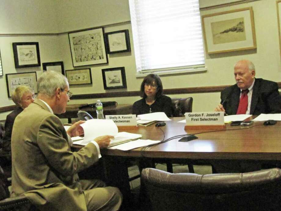 Town Attorney Ira Bloom talks with Selectman Shelly Kassen and First Selectman Gordon Joseloff (as well as Selectman Charlie Haberstroh on speakerphone) minutes before the Board of Selectmen voted to officially terminate a lease agreement for Green Village Initiative (GVI) to manage the Wakeman Farm & Sustainability Center. The town will now oversee the 2.2-acre site. Photo: Contributed Photo / Westport News contributed
