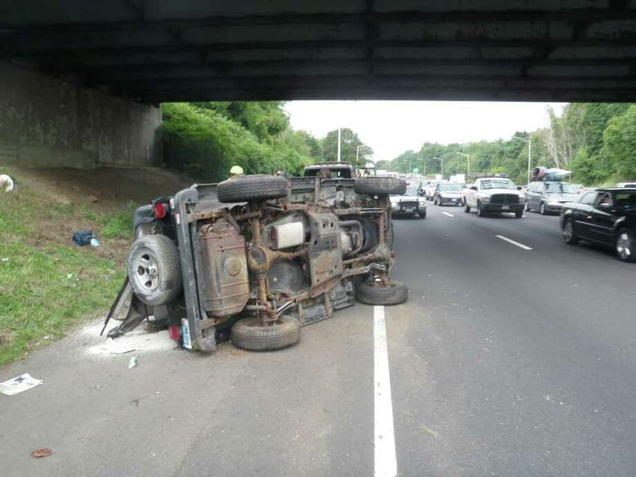 One woman was injured when her SUV rolled over on Interstate 95 in Westport on Thursday, Aug. 18, 2011. Photo: Contributed Photo