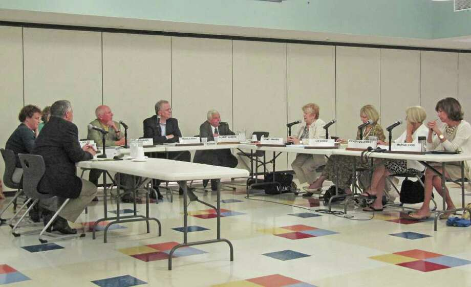 Westport Superintendent of Schools Elliott Landon brought up at Monday's Board of Education meeting the fact that parents of children going from 8th grade into 9th have to re-register their kids. This is done largely to weed out non-residents enrolled in the school system. This summer's re-registration led to the discovery of 20 non-resident children, according to Landon, fifth from right in this photo. Photo: Kirk Lang / Westport News contributed