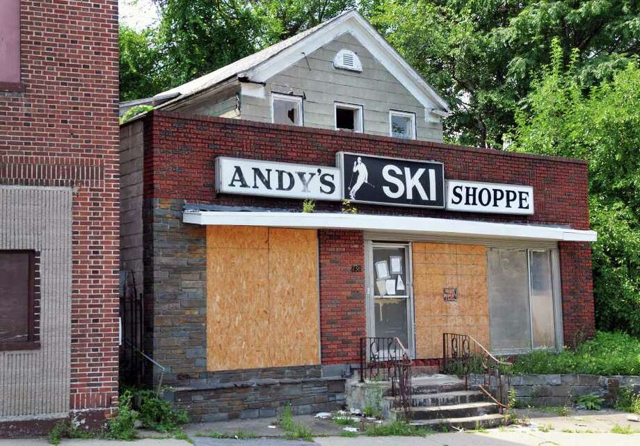 Exterior of the former Andy's Ski Shoppe at 738 Albany Street in Schenectady Thursday Aug. 18, 2011.  Neighbors say that a dead body was found in the apartment above the shop.  (John Carl D'Annibale / Times Union) Photo: John Carl D'Annibale