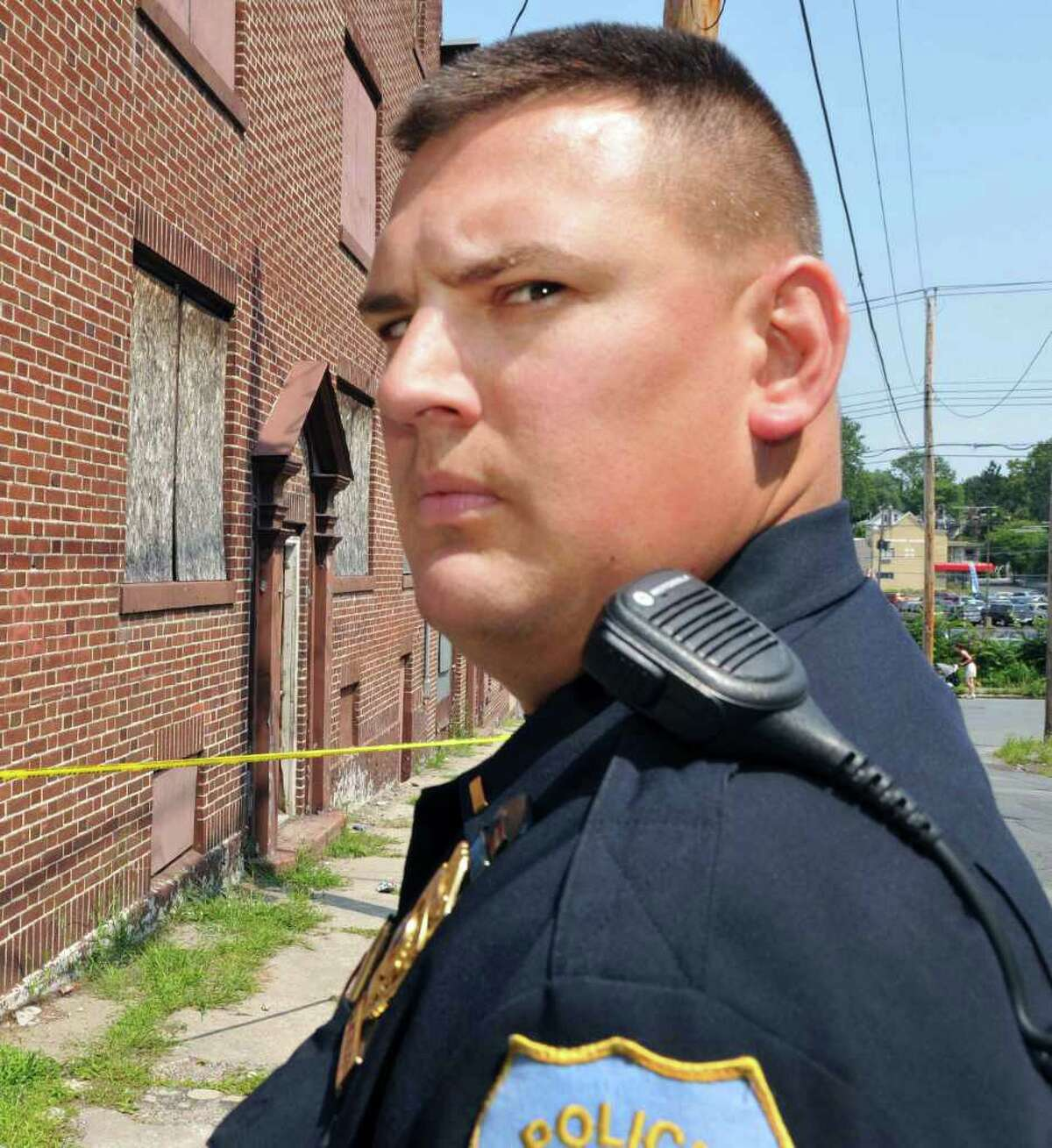 Schenectady police Lt. Mark McCracken at the former Andy's Ski Shoppe at 738 Albany Street in Schenectady Thursday Aug. 18, 2011. Neighbors say that a dead body was found in the apartment above the shop. (John Carl D'Annibale/Times Union archive)