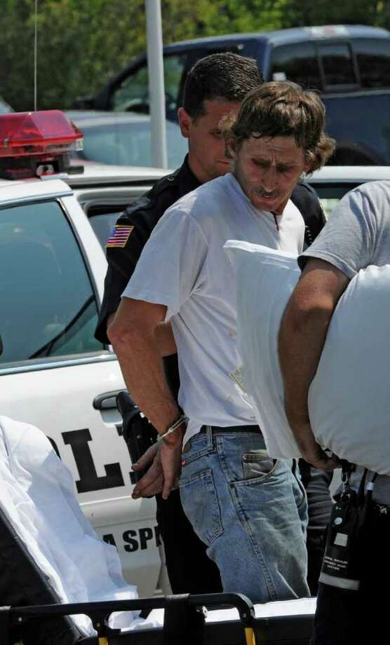 Daniel Burgess is taken in to custody by the Saratoga Springs, N.Y. police Aug 18, 2011, after driving his car in to Saratoga Lake after an alleged dispute.   (Skip Dickstein / Times Union archive) Photo: SKIP DICKSTEIN
