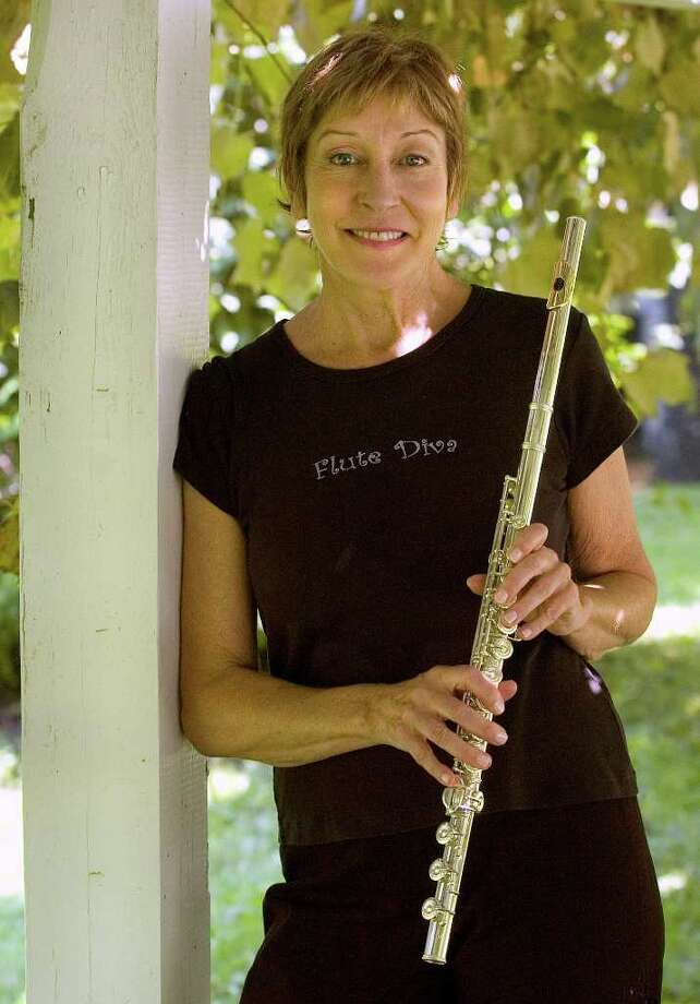"Brookfield resident Ali Ryerson poses with her custom-made Gemeinhardt Brio! flute on Thursday, Aug. 18, 2011, at Brookfield Library, where she will will give a free CD release party preformance with the Ali Ryerson Quintet on Sunday, Aug. 21 on the lawn.  Her new album is, ""Con Brio!"" Photo: Jason Rearick / The News-Times"