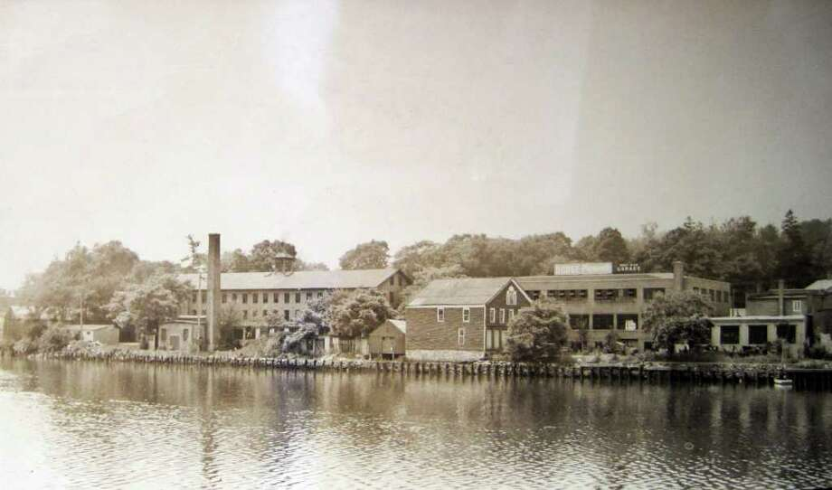 Above is a Westport Historical Society photo of the Gault & Son buildings on the west side of the Saugatuck River during the 1920s. The Westport Historical Society and the Westport Arts Center will give a tour of the Saugatuck area Saturday, Aug. 27. Photo: Contributed Photo