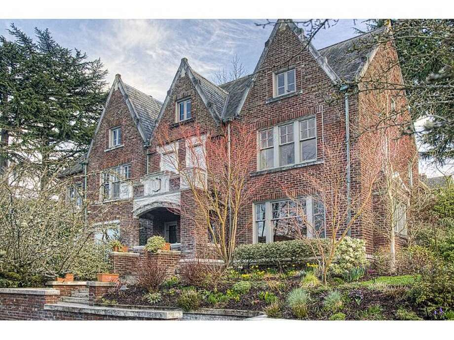 Ever dreamed of living in a big, old, brick mansion on Capitol Hill? If you've got $2.395 million, you can buy this one, at 2005 E. Galer St. The 6,900-square-foot house, built in 1920, has five bedrooms and four bathrooms, including a massive master suite, plus a billiards room, sun room, tons of oak and built-ins, a gabled slate roof and a 8,740-square-foot lot with a patio, gardens and a basketball court. (Listing: www.windermere.com/index.cfm?fuseaction=listing.listingDetailUpdated&listingID=129858822) Photo: Windermere Real Estate