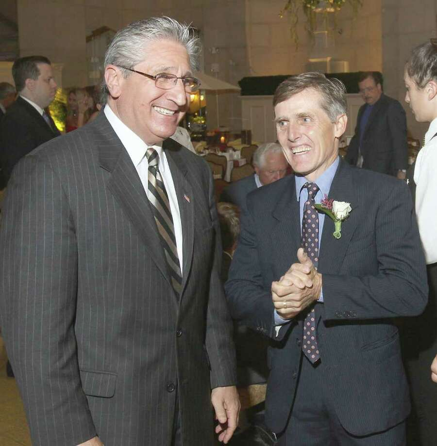 Saratoga Springs, NY - August 15, 2011 - (Photo by Joe Putrock/Special to the Times Union) - NYS Assemblyman James Tedisco(left) talks with retired jockey and event honoree Robbie Davis(right) during the Dare to Dream Gala to benefit The Prevention Council. Photo: Joe Putrock / Joe Putrock