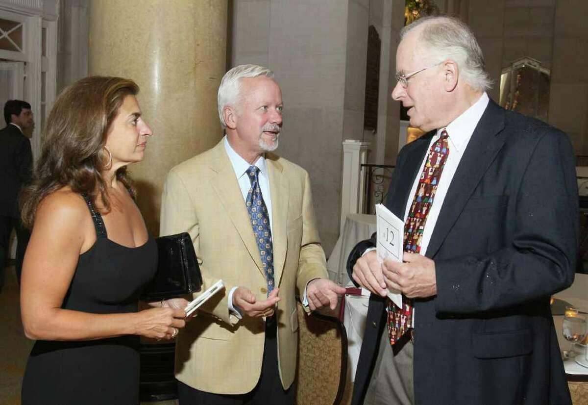Saratoga Springs, NY - August 15, 2011 - (Photo by Joe Putrock/Special to the Times Union) - Doug Mills(right) talks with Saratoga Springs Mayor Scott T. Johnson(center) and his wife Julie(left) during the Dare to Dream Gala to benefit The Prevention Council.