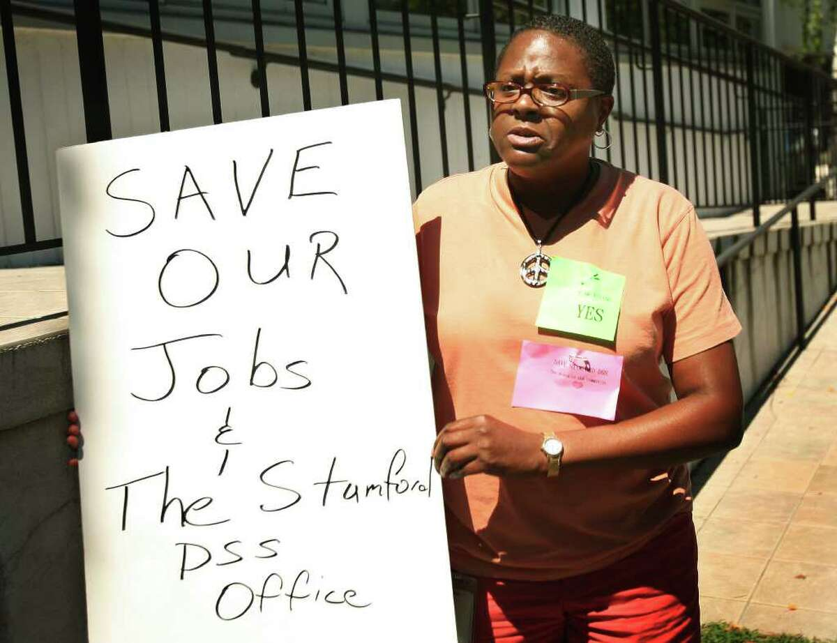 Veronica Jones of Stamford protests the possible closing of Department of Social Services office in Stamford at a lunch hour rally on Thursday, August 11, 2011. Jones and other employees were urging members of their union to vote in favor of the agreement reached with the Malloy Administration.