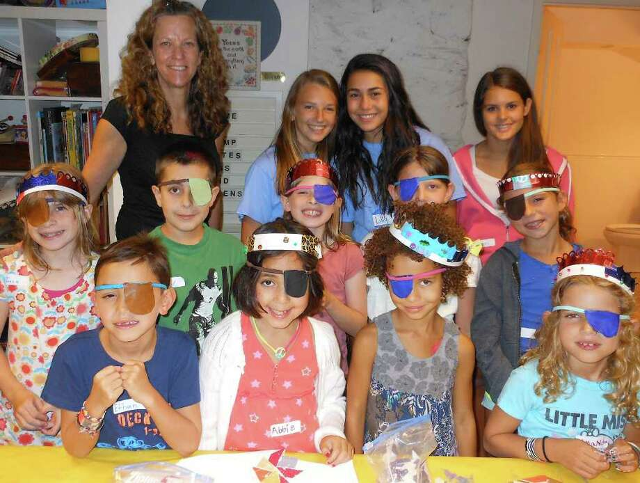 """Pirates, Kings & Queens"" summer program participants with Westport Historical Society Education Director Elizabeth DeVoll and teen assistants. Photo: Mike Lauterborn / Westport News contributed"