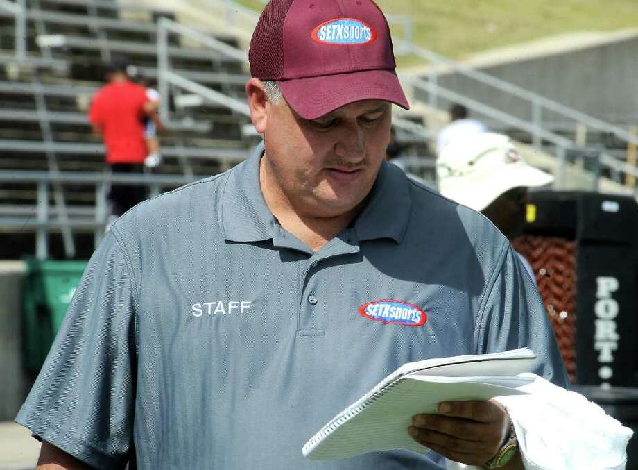 Local broadcaster, Mike Sanchez takes notes during a scrimmage between Kirbyville and Silsbee at Silsbee High School in Silsbee, Saturday. Tammy McKinley/The Enterprise Photo: TAMMY MCKINLEY