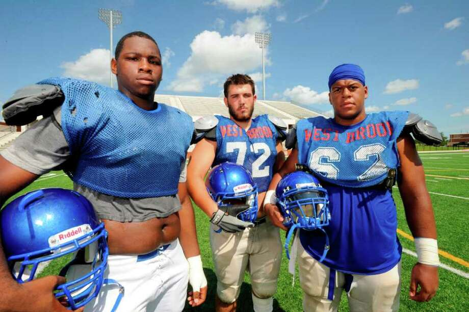 West Brook offensive linemen, from left, Jared Castle, Emory Cothen, and Jermaine Bowman, are set to make an impact for the Bruins on the front lines as the 2011 season nears. Photographed at the Carrol A. Butch Thomas Educational Support Center.  Friday, August 12, 2011.  Valentino Mauricio/The Enterprise Photo: Valentino Mauricio