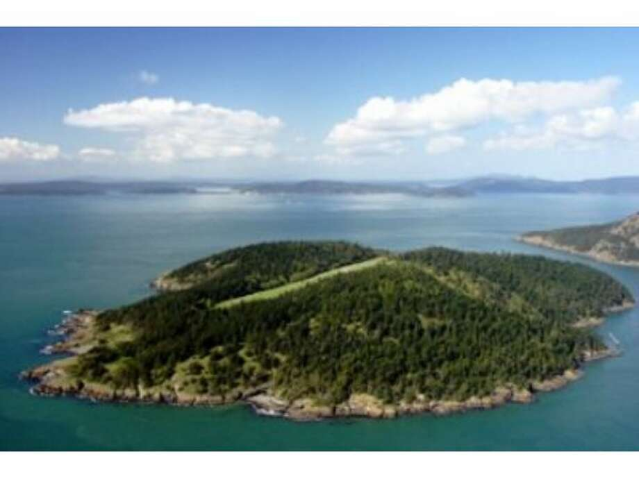 If the recent lousy economic news has you wanting to flee to a private island, Paul Allen has one to sell you. Allan Island (named after a Navy hero) is 292 acres southwest of Anacortes,between Burrows Bay and Rosario Strait. Allen bought it in 1992 with a plan to build a vacation home there, but subsequently opted to build on Lopez Island, where he bought 387 acres in 1996. Allen put the island up for sale for $25 million on 2005. It's now listed for $13.5 million. The Island features a log home, airstrip, dock, beaches and 44 tax lots. Here are some more pictures of Allan Island, followed by some other islands for sale across the country. (Listing: www.windermere.com/index.cfm?fuseaction=listing.listingDetailUpdated&listingID=18537393) Photo: Windermere Real Estate