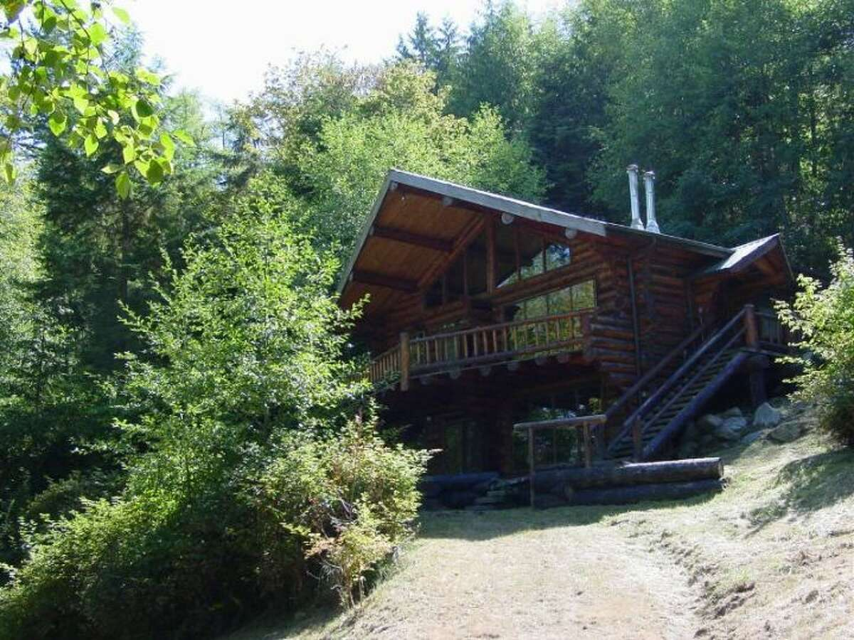 Allan Island comes with this log home.
