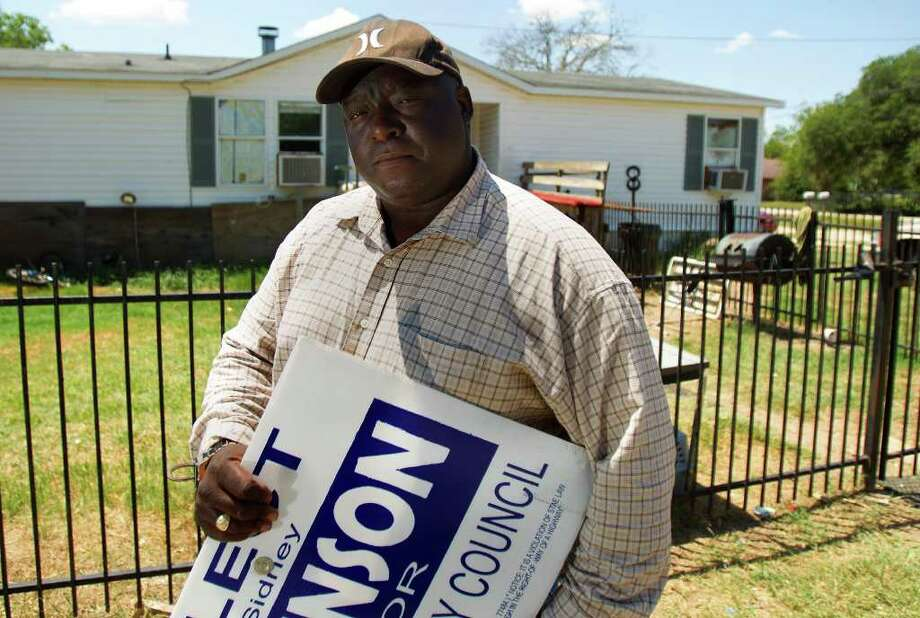 "Sidney Johnson leans on one of his campaign signs in front of his house Wednesday, Aug. 17, 2011, in Waller. Johnson is currently involved in an FBI investigation into voter fraud that prevented him from becoming the first black ever elected to city council in Waller. ""I think I can make a difference,"" Johnson said. ""That's all I want is to make a difference."" (Cody Duty / Houston Chronicle ) Photo: Cody Duty, Staff / © 2011 Houston Chronicle"