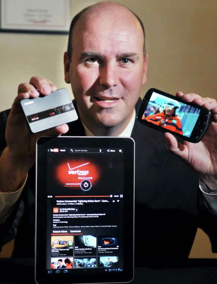 Verizon data sales manager Chris McDonough showcases new 4G service and phone in Colonie Thursday Aug. 18, 2011.   (John Carl D'Annibale / Times Union) Photo: John Carl D'Annibale / 00014331A