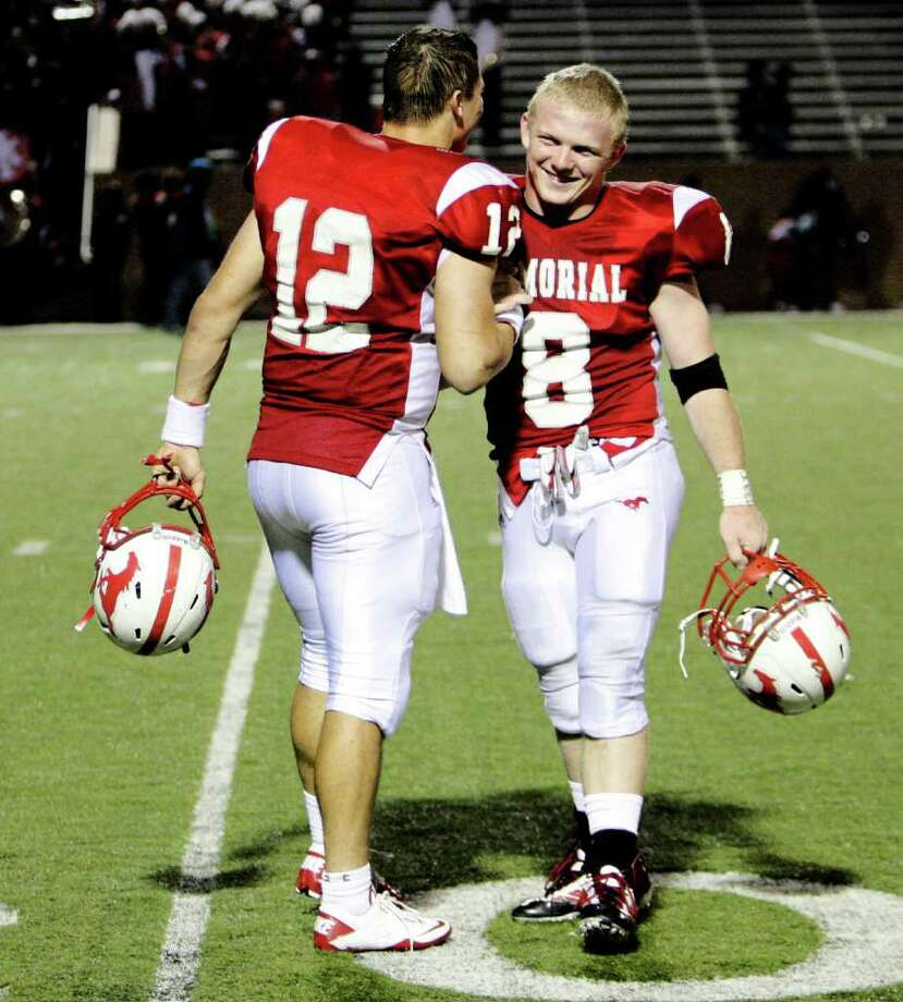 Quarterback Wayne Tayor and running back Boomer White celebrate after their win over Alief Taylor during the second round of Class 5A Division II Region III tournament as Alief Taylor faces Memorial Friday November 19, 2010 at Rhodes Stadium in Katy. Photo: Bob Levey, Freelance / Freelance