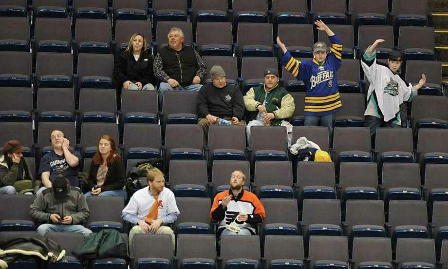 "A couple hockey fans dance to the song ""YMCA"" during a hockey game between the Albany Devils and the Bridgeport Sound Tigers at the Times Union Center in Albany, NY on Wednesday, March 9, 2011. (Lori Van Buren / Times Union) Photo: Lori Van Buren / 00011283T"