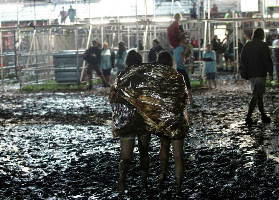The scene after a storm swept through an open air music festival near Hasselt, about 50 miles (80 kilometers) east of Brussels, Belgium, Thursday, Aug. 18, 2011. The storm killed at least three people and injured over 70 others, an official said.  (AP Photo/Yves Logghe) Photo: Yves Logghe / AP
