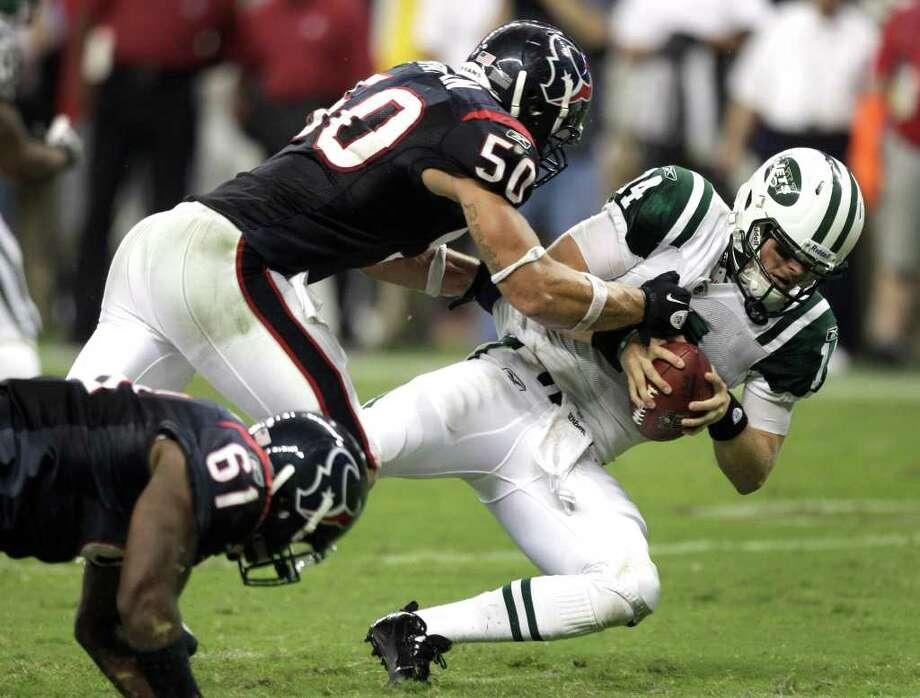 Houston Texans linebacker Bryan Braman (50) sacks New York Jets quarterback Greg McElroy (14) during the fourth quarter of an NFL football game at Reliant Stadium Monday, Aug. 15, 2011, in Houston. The Texans beat the Jets 20-16.  ( Brett Coomer / Houston Chronicle ) Photo: Brett Coomer, Staff / © 2010 Houston Chronicle