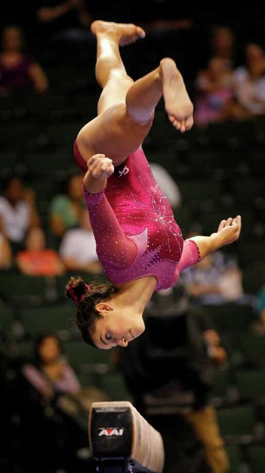 Alexandra Raisman concentrates on her landing on the balance beam during the 2011 Visa Gymnastics National Championships at the XCel Energy Center in St. Paul, Minnesota, on Thursday, August 18, 2011. (Brian Peterson/Minneapolis Star Tribune/MCT) Photo: Brian Peterson, MBR / Minneapolis Star Tribune