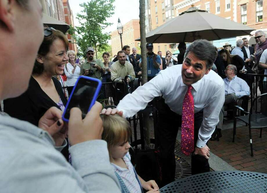 """Campaigning in New Hampshire, Gov. Rick Perry said: """"We teach both creationism and evolution in our public schools."""" Photo: Darren McCollester/Getty Images / 2011 Getty Images"""