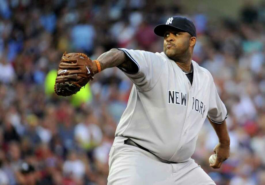 MINNEAPOLIS, MN - AUGUST 18: CC Sabathia #52 of the New York Yankees delivers a pitch against the Minnesota Twins in the first inning on August 18, 2011 at Target Field in Minneapolis, Minnesota. (Photo by Hannah Foslien/Getty Images) Photo: Hannah Foslien