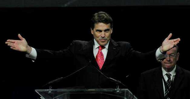 Gov. Rick Perry speaks at the closing of The Response, a daylong prayer rally and fast Aug. 6 at Houston's Reliant Stadium. Event organizer Don Wildmon is calling on attendees to help register millions of conservative Christians to vote. Photo: Pat Sullivan/Associated Press