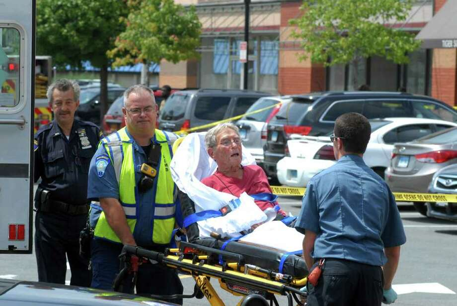 Samuel Leighton, 92, who drove into Cafe Oo La La in the Ridgeway Shopping Center in Stamford, Conn. injuring 10 people on Monday August 8, 2011 is taken to the hospital. He was charged Aug. 18 with reckless endangerment and reckless operation. Photo: Dru Nadler / Connecticut Post