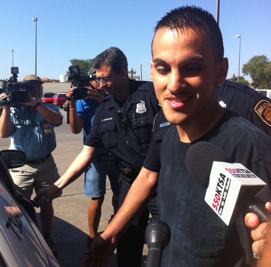 Victor Padilla is greeted by media as he is escorted to jail from the city's police headquarters. Photo: Ana Ley/aley@express-news.net